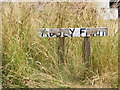 TM3186 : Abbey Farm sign by Adrian Cable
