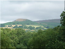 SO2220 : Crug Hywel from a hillside path near Llangenny by Jeremy Bolwell