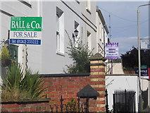 SO9621 : Estate agents' boards on Cudnall Street, Charlton Kings by David Howard