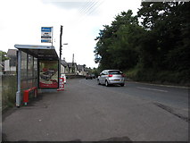 J4059 : Depot Bus Stop on the A7 at Saintfield by Eric Jones