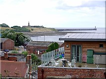 NZ3668 : View over North Shields to Collingwood Memorial and North Pier, Tynemouth by Andrew Curtis