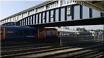 TQ2775 : Train approaching carriage sidings, Clapham Junction by Christopher Hilton