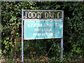 TM1086 : Lodge Drive sign by Adrian Cable
