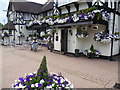 TQ2456 : Flowers outside the Kingswood Arms by Marathon