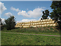 SK9308 : Hay bales at Sykes Spinney (1) by Stephen Craven