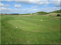 NU2422 : The 18th tee at Dunstanburgh Castle Golf Club by Graham Robson