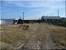 TR0916 : Approach to the shacks, Dungeness by Marathon