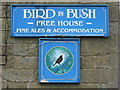 NY9393 : Sign for The Bird in Bush, Elsdon by Mike Quinn