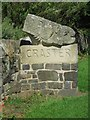 NU2519 : Carved sign at entrance to Craster by Graham Robson