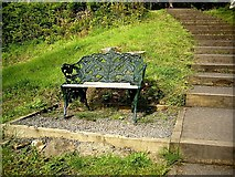 NU0702 : An ornamental bench seat, Cragside by Stanley Howe