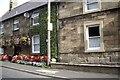 NU0202 : Roadside houses in Thropton by Stanley Howe