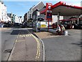 SS5147 : Filling station and bus stop in Ilfracombe High Street by David Smith