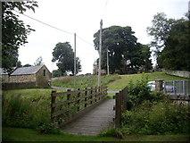 NY9393 : Wooden footbridge over  Elsdon Burn by Stanley Howe