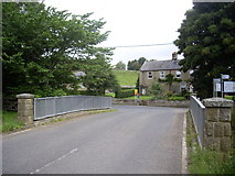 NY9393 : Dogleg bend in the B6341 near Elsdon Bridge by Stanley Howe