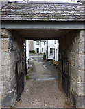 SX7087 : Gate leading from the church of St. Michael the Archangel, Chagford by pam fray