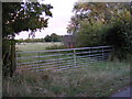 TM1182 : Field entrance off Heywood Road by Adrian Cable