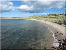 NU1535 : Looking along the coast from the old pier on the south side of Budle Bay by Graham Robson
