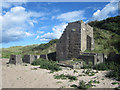 NU1635 : Former stone crushing plant, Budle Bay by Graham Robson