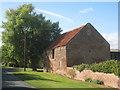 SE7824 : Barn at Sowby's Farm, Saltmarshe by Jonathan Thacker