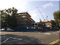 TQ3977 : Rebuilding of John Roan School by Stephen Craven