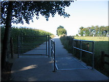 SP2973 : Gate and cattle grid, cycle route 52 by E Gammie