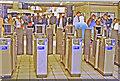 TQ2579 : Barriers at High Street Kensington, London Underground Circle Line, 1993 by Ben Brooksbank