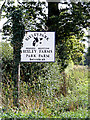 TG2505 : Bixley Park Farms sign by Adrian Cable