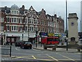 TQ2587 : Shops and war memorial, Golders Green by Andrew Hill