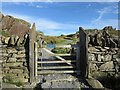 SH5852 : Quarry road rising beyond gate by Trevor Littlewood