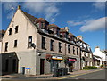 NJ9530 : Shops with flats above, Ythan Terrace, Ellon by Bill Harrison