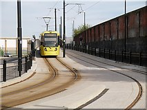 SD8912 : Metrolink Tram on High Level Road by David Dixon