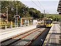 SD9311 : Metrolink tram Arriving at Newhey by David Dixon
