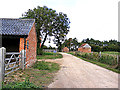 TM3093 : Entrance to The High House & Brickyard Farm by Adrian Cable