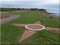 SY0279 : Compass rose on the ground at Orcombe Point by David Smith