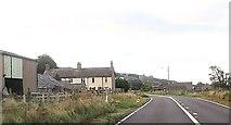 SH5832 : Gilarwen and phone box on A496 by John Firth