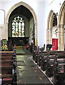 TF5914 : Wiggenhall St Germans: nave, chancel arch and benches by John Sutton