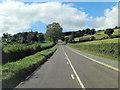 SJ2630 : B4580 passes Underhill Farm by Stuart Logan