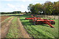 SP6604 : Plough beside track approaching Home Farm by Roger Templeman