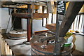 SS9943 : Dunster Watermill - stones by Chris Allen