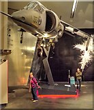 SJ8097 : Imperial War Museum North, Harrier Jet Aircraft by David Dixon