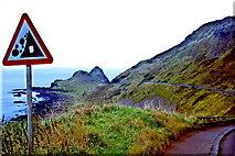 C9444 : Antrim Coast - Giant's Causeway - Falling Rock Warning Sign by Joseph Mischyshyn