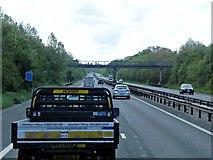 TQ8959 : Southbound M2 approaching Footbridge by David Dixon