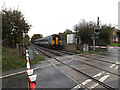 TM3863 : Train approaching Chantry Road Level Crossing by Adrian Cable