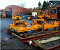 SO6413 : Yellow machinery inside a yard in Cinderford by Jaggery