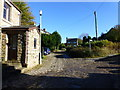 SD9411 : Cobblestone road at Haugh by Raymond Knapman