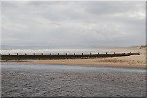 NJ2370 : Part of the river Lossie and old breakwater. by jeff collins