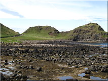 C9444 : The Great Stookan headland viewed across the boulder strewn beach at Port Granny  by Eric Jones
