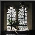 TL3149 : Croydon: All Saints - through a south aisle window by John Sutton