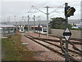 NT1573 : Tram crossing and signal by M J Richardson