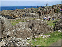 C9444 : View past weathered basalt boulders to the polygonal columns of the Giant's Causeway by Eric Jones